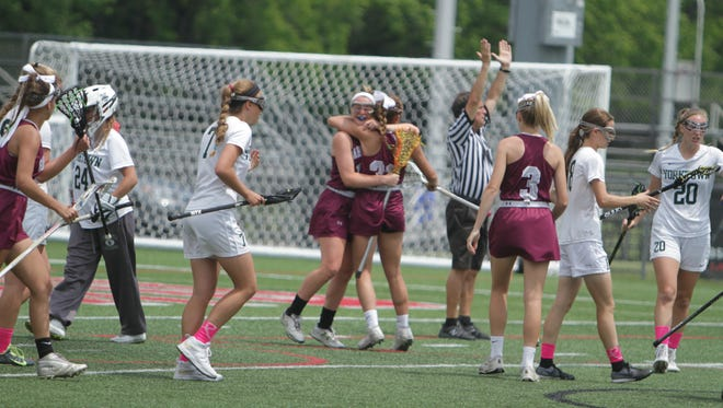 Garden City celebrates after a first-half goal during the New York State girls lacrosse Class B state final between Yorktown and Garden City at SUNY Cortland on Saturday, June 11th, 2016. Garden City won 16-5.