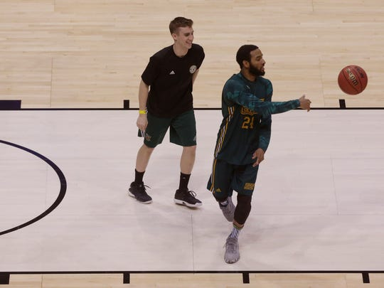 Vermont guard Dre Wills (24) i shown during practice before the first round of the NCAA Division I Men's Basketball Championship Wednesday, March 15, 2017 at the BMO Harris Bradley Center in Milwaukee, Wis.