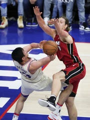 Sixer Ersan Ilyasova shoots against Miami's Kelly Olynyk in the second half of the Sixers' 104-91 win in game five of an opening round playoff series at the Wells Fargo Center in Philadelphia Tuesday.