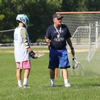 Gaffer Elite Lacrosse coach Kent Maslin watches as players participate in a shooting drill during a recent practice at Henry Minier Athletic Field in Big Flats.