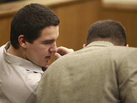 Anthony Zarro speaks with his attorney during a 2013 court appearance.