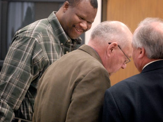 Preston Fenderson has a light moment with attorneys Robert Whitney and Bernie Davis in Common Pleas Court. Fenderson was convicted of murder during his 2009 trial.