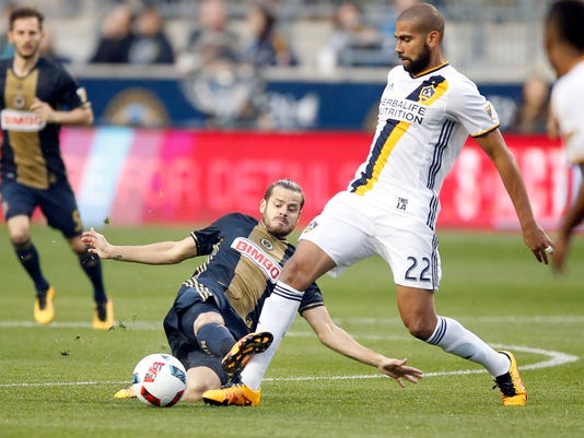 Philadelphia Union midfielder Tranquillo Barnetta (10) goes after the ball from the grass against Los Angeles Galaxy defender Leonardo (22) during the first half of an MLS soccer match Wednesday, May 11, 2016, in Chester, Pa. (Yong Kim/The Philadelphia Inquirer via AP)