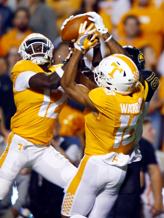 Tennessee defensive back Emmanuel Moseley (12) and defensive back Nigel Warrior (18) break up a pass intended for Southern Mississippi wide receiver Korey Robertson (18) in the first half of an NCAA college football game Saturday, Nov. 4, 2017, in Knoxville, Tenn. (AP Photo/Wade Payne)
