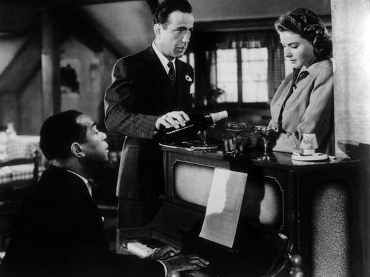 Dooley Wilson (from left), Humphrey Bogart and Ingrid