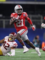 Ohio State H-back Parris Campbell runs a reverse against