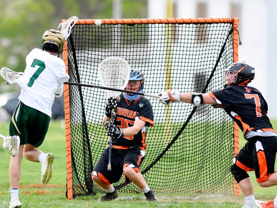 York Catholic's Dimitri Amalfitano, left, shoots on