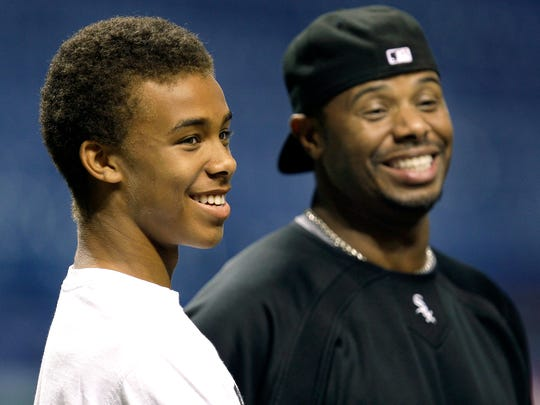 Ken Griffey Jr., right, shares a laugh with his son