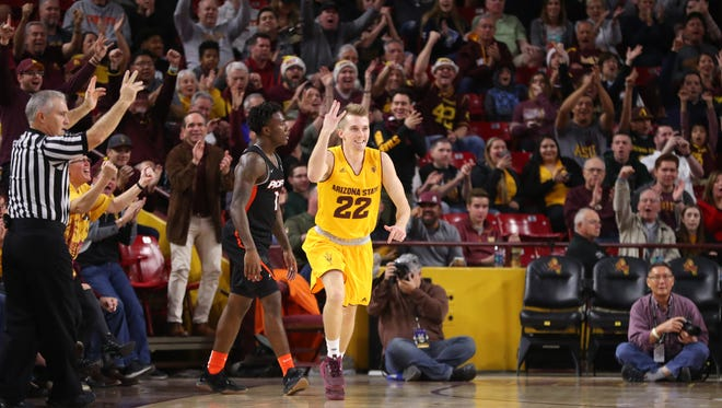ASU's Austin Witherill (22) throws up a three sign after hitting a corner three against Pacific during the second half at Wells Fargo Arena on December 22, 2017 in Tempe, Ariz.