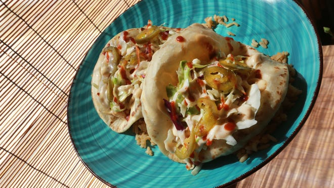 These are puffy tacos from Jonbalaya restaurant.