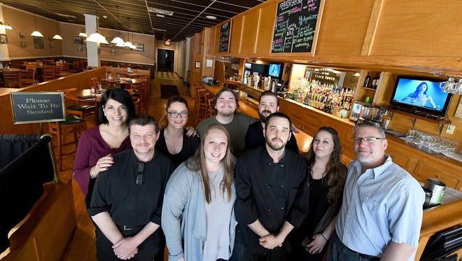 The new co-owners of the Clocktower Restaurant & Bar are photographed with their staff on Monday, April 30, 2018.