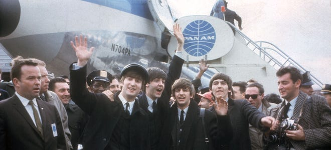 The Beatles arrive in New York on Feb. 7, 1964, for their first U.S. appearances. From left are: John Lennon, Paul McCartney, Ringo Starr and George Harrison.