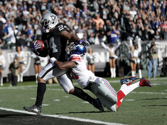 FILE - In this Dec. 3, 2017, file photo, Oakland Raiders running back Marshawn Lynch (24) scores a touchdown in front of New York Giants cornerback Dominique Rodgers-Cromartie during the first half of an NFL football game in Oakland, Calif. The Raiders face the Kansas City Chiefs this week. Lynch is coming off his first 100-yard performance of the season, and the star running back is starting to look like the Beast Mode of old. (AP Photo/Marcio Jose Sanchez, File)