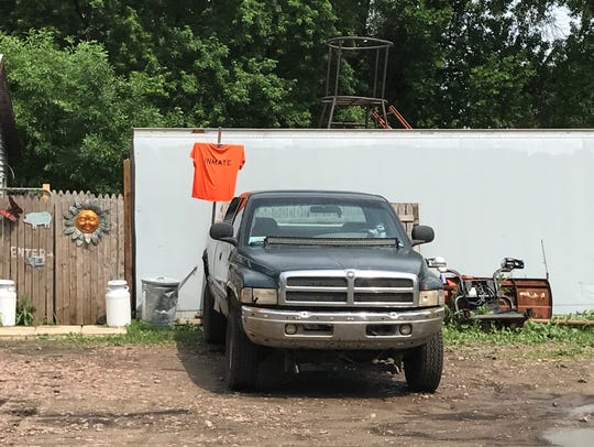 "A shirt saying ""inmate"" hangs on the property of Glenn"