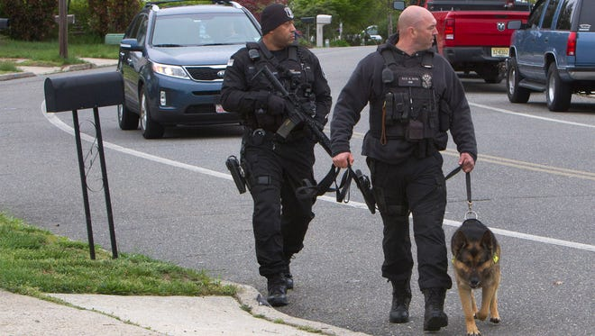 Police search Settlers Landing area in Barnegat Township for an escaped prisoner.