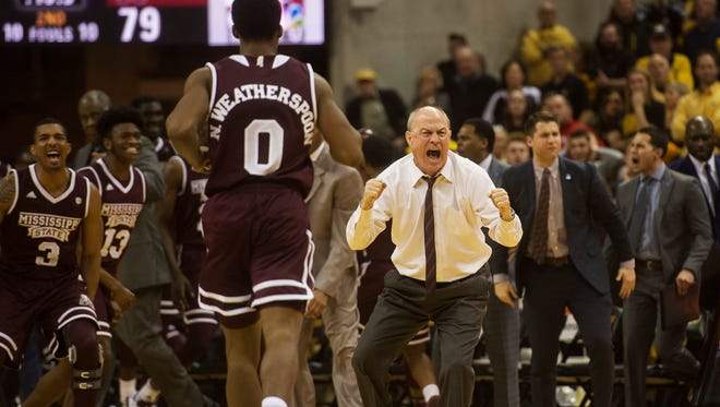 Mississippi State head coach Ben Howland celebrates with his team after they tied the game at the end of regulation against Missouri.
