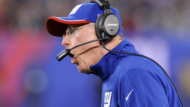 Giants head coach Tom Coughlin reacts during the first half of his team's 40-24 loss to the Indianapolis Colts Monday night.
