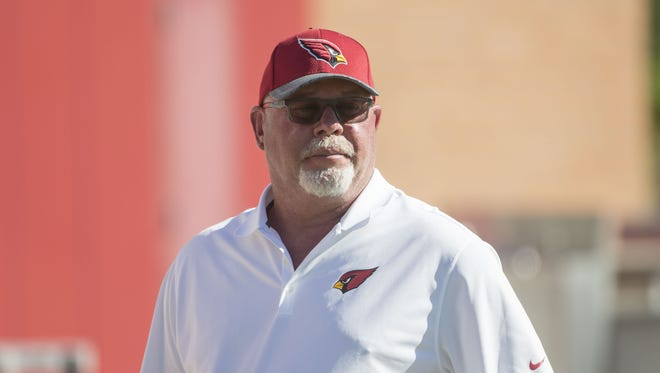 Cardinals head coach Bruce Arians watches over practice at the Cardinals Training Facility in Tempe, Ariz. on May 24, 2017.