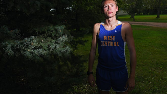 West Central High School cross country runner Derick Peters, 16, a junior, poses for a portrait Monday, Oct. 3, 2016, outside the West Central High School in Hartford, S.D.