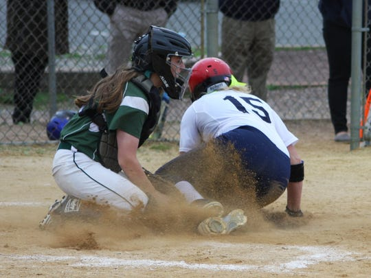 Raritan catcher Michelle Nestor tags out Toms River North's Sam Reilly at home during the fourth inning of the Mariners' 5-2 win over the Rockets in the Shore Conference Tournament quarterfinals on Wednesday.