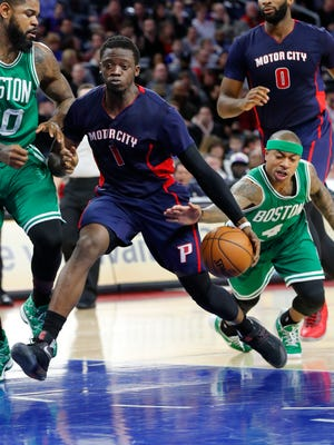 Celtics guard Isaiah Thomas (4) reaches for the ball as Pistons guard Reggie Jackson (1) drives in the first half Sunday at the Palace.
