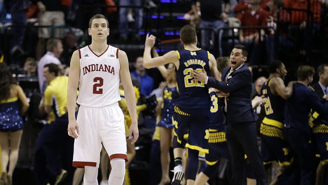 A dejected Nick Zeisloft (2) walks off the court after Michigan hit a game-winning shot in the final seconds of the second half of their Big Ten Men's Basketball Tournament game Friday, Mar 11, 2016, afternoon at Bankers Life Fieldhouse. The Indiana Hoosiers lost to the Michigan Wolverines 69-72.