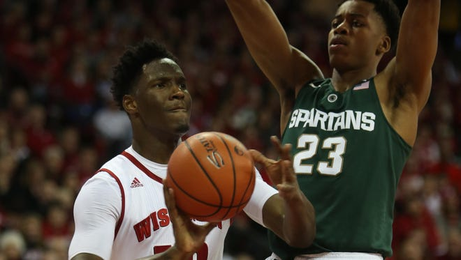 Wisconsin's Nigel Hayes, left, scored 25 points in the first meeting against MSU this season, on Jan. 17 in Madison.