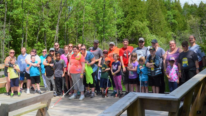 KAMP-OUT participants prepare for advenutre on the Ridges Hidden Brook Boardwalk, which is designed for people with disabilities to experience nature.