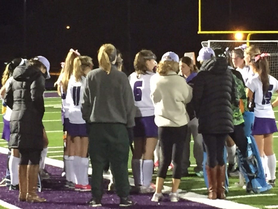 John Jay coach Heather Ausiello regroups her team following a slow start to the second half.