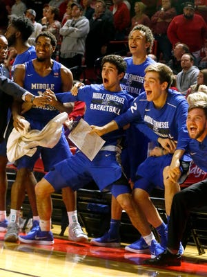 MTSU's bench celebrates a basket during the final seconds of the game against Western Kentucky on Saturday.