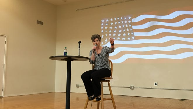 U.S. Sen. Joni Ernst answers questions during a town meeting in Panora on Friday.