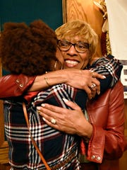 Carol Hill-Evans is hugged by her daughter, Darlene Beckett, of Killeen, Texas, after winning the Pennsylvania Legislature's 95th District seat. York County Democrats gathered for an election results watch party at Roosevelt Tavern in York City, Tuesday, Nov. 8, 2016. Dawn J. Sagert photo