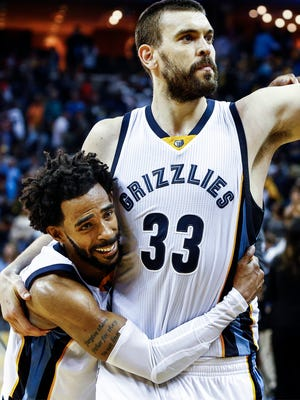 Memphis' Marc Gasol (33) celebrates with Mike Conley after hitting the winning shot in overtime of the Grizzlies' 110-108 win over the San Antonio Spurs in Game 4 of the first-round series on April 22, 2017, at FedEx Forum.