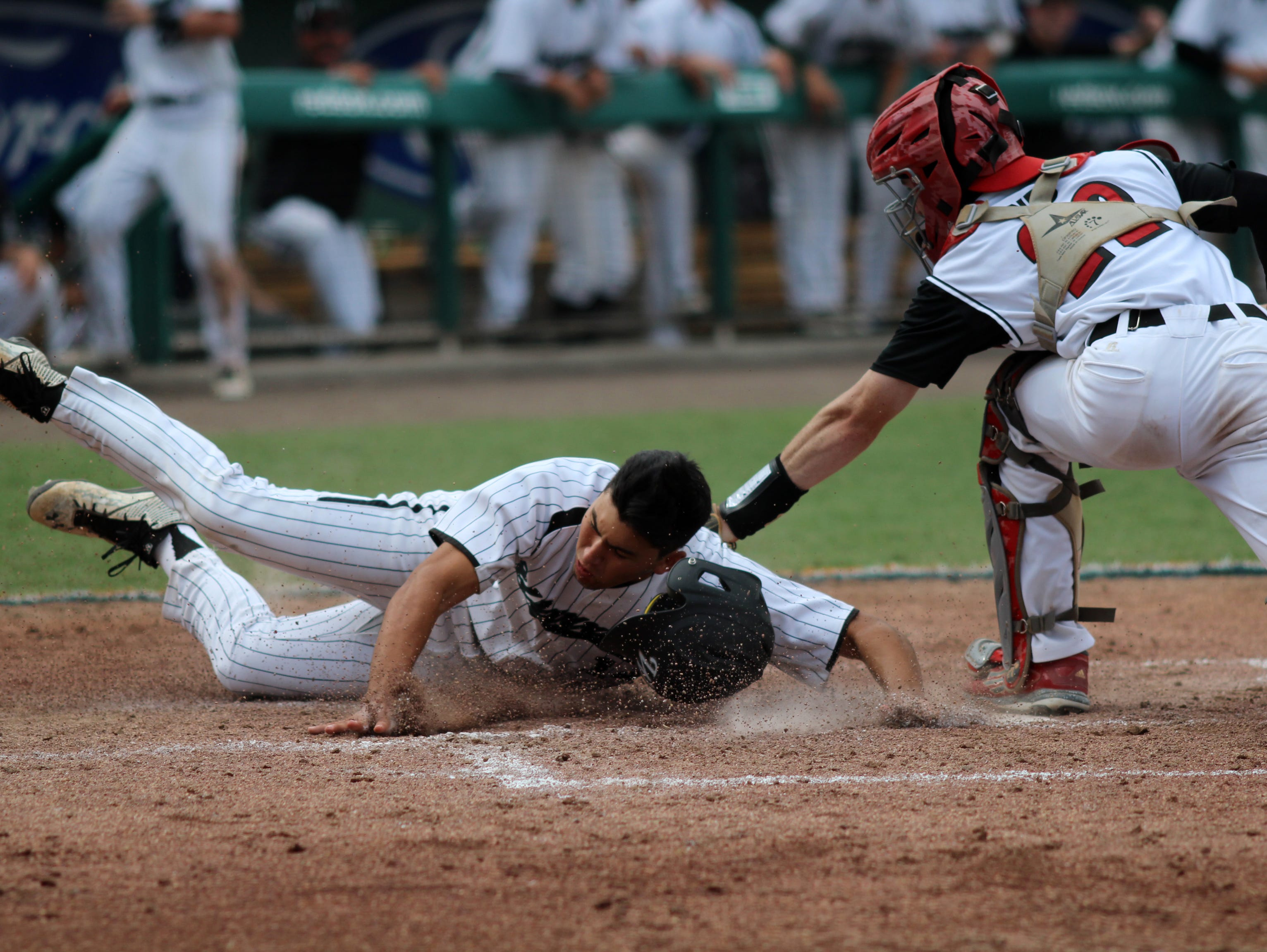 NFC catcher Taylor Schmidt reaches for the tag during Tuesday's FHSAA Class 3A State Championship game at jetBlue Park in Fort Myers, Florida.