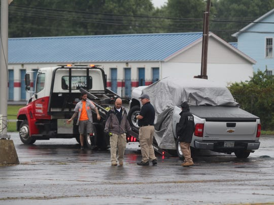 Authorities remove the truck that was found Thursday morning on Fort Campbell Boulevard with a body inside.