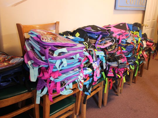 Backpacks are sorted and ready to be filled.