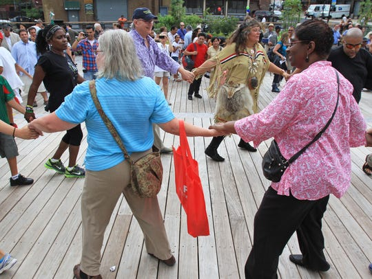 Spectators participate in the friendship dance at the