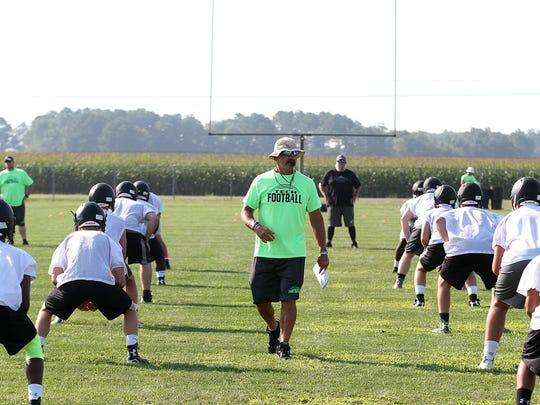 Sussex Tech assistant coach Jim Durkin warms up the team as practice gets started Monday morning.