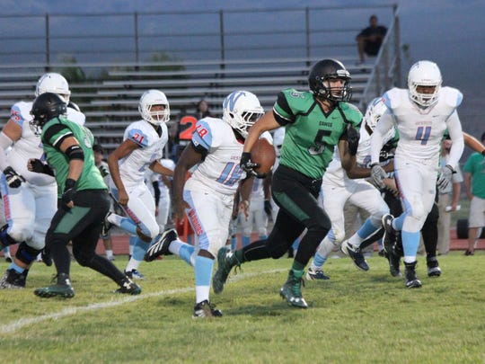 Western players chase Bulldog player Cody Jones in a recent game.