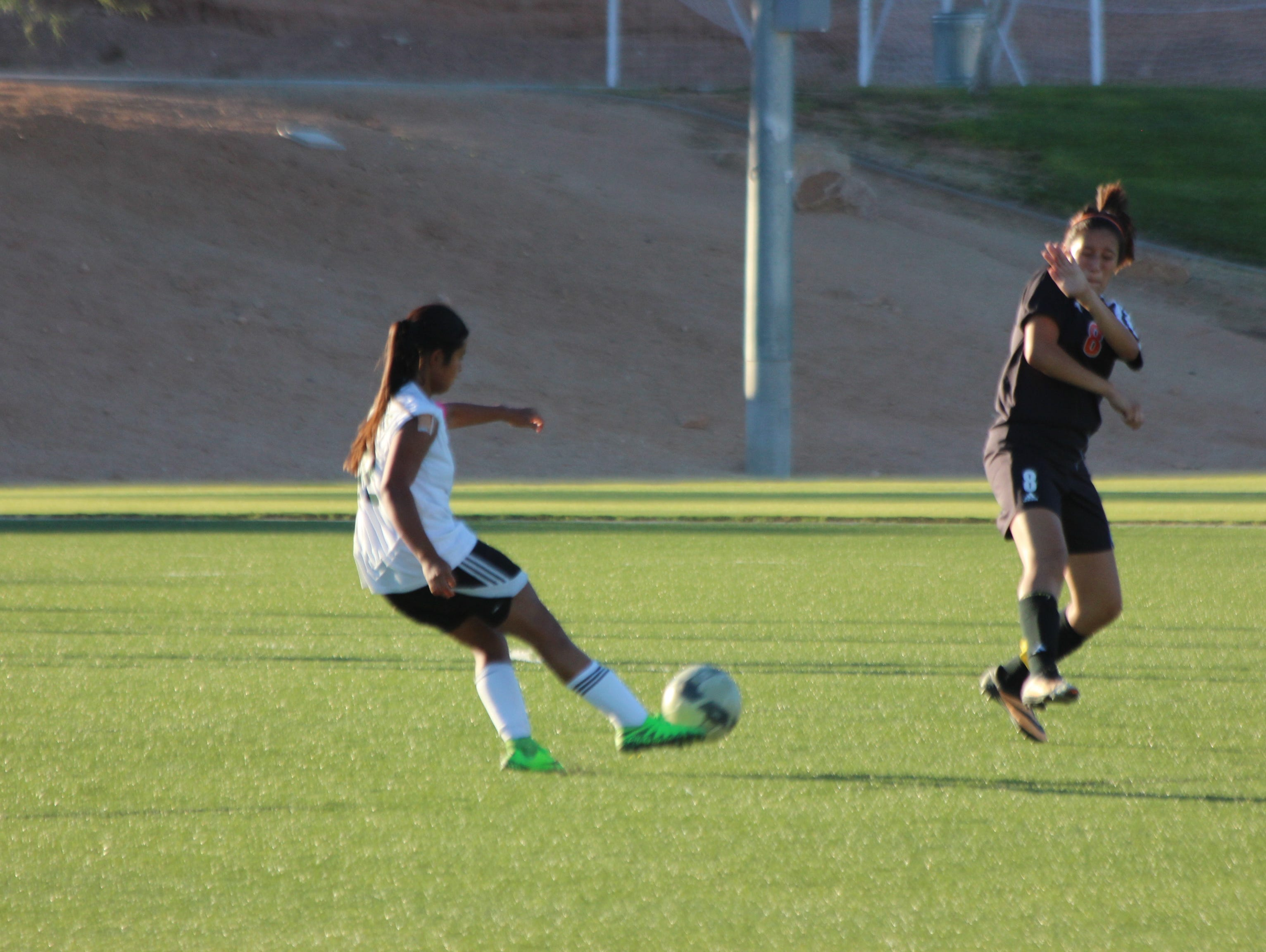 Senior Marlene Quirarte launches a kick during Friday's game against Chaparral.