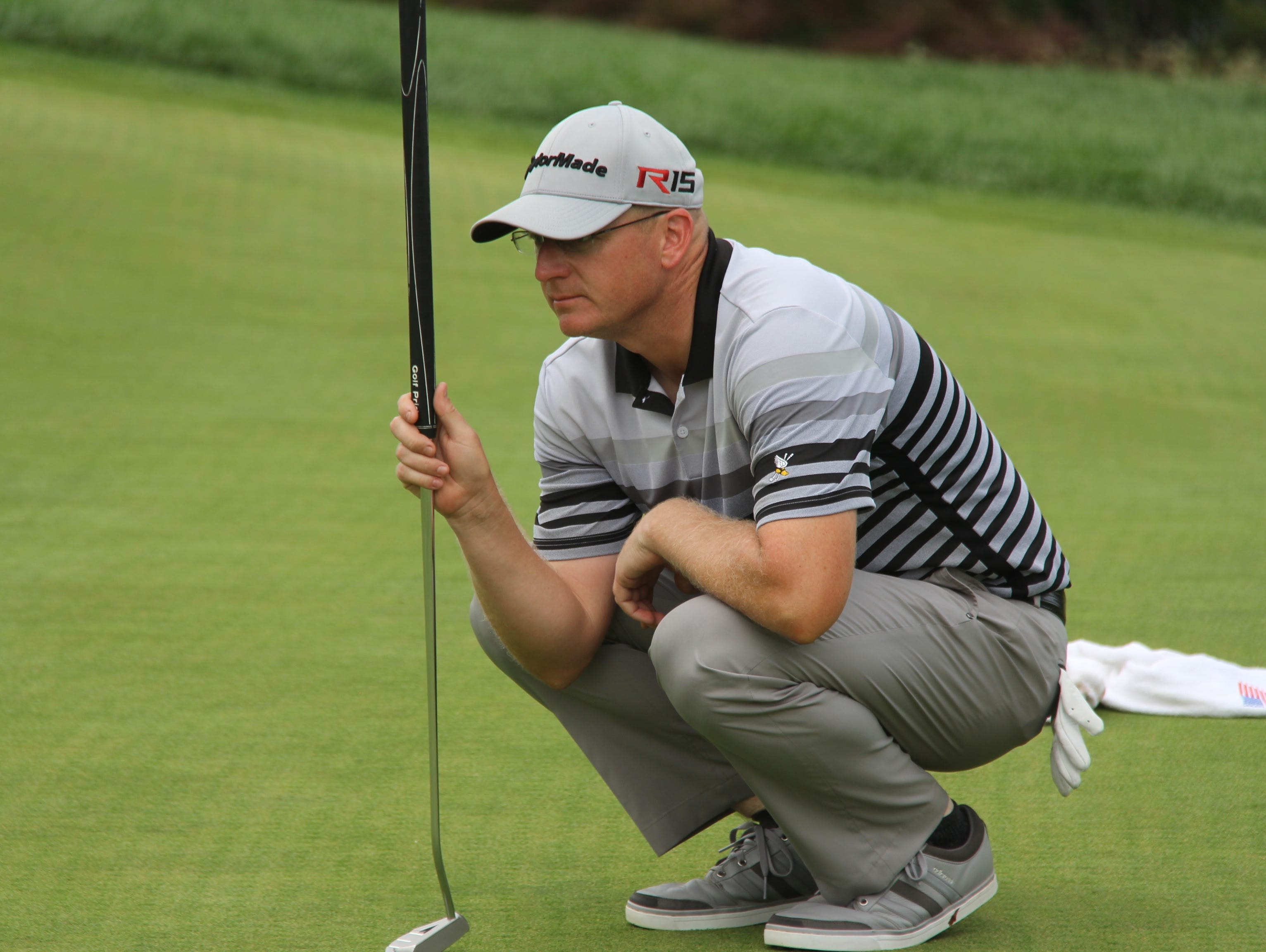 Winged Foot's Grant Sturgeon lines up a putt Tuesday during the first round of the Met PGA Championship at Fenway Gold Club.