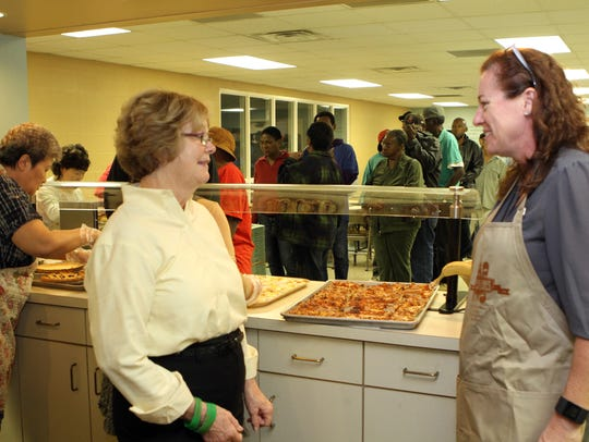 Jill Crow, Loaves & Fishes board member, left, and