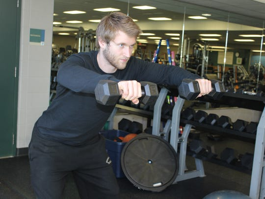 Raise dumbbells to shoulder level and parallel to the floor.