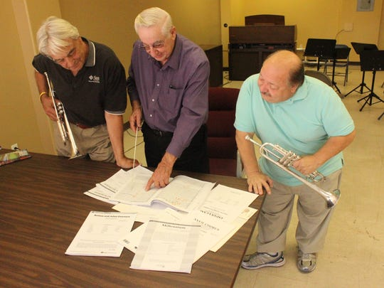 SNSO members, from left, Jan Sando, Selmer Spitzer and Rick Boniface check out some musical numbers.