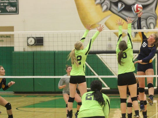 VVHS players Emma Barnum and Dylan Bryant go for a block at the net during a recent match against Boulder City.