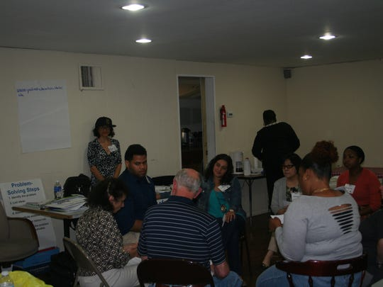 Volunteers train to be Peer Leaders during HQSI-sponsored Diabetes Self-Management training in Colonia in June.