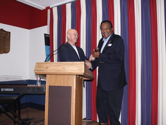 Outgoing Unified Arizona Veterans Chairman Rob Welch (left) hands the gavel to the incoming chairman, Reggie Yates.