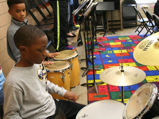 "Students rehearse at Buckman Heights in Greece. The rhythm section is in the pocket playing an arrangement of ""We Three Kings"" called ""Kings of Swing."""