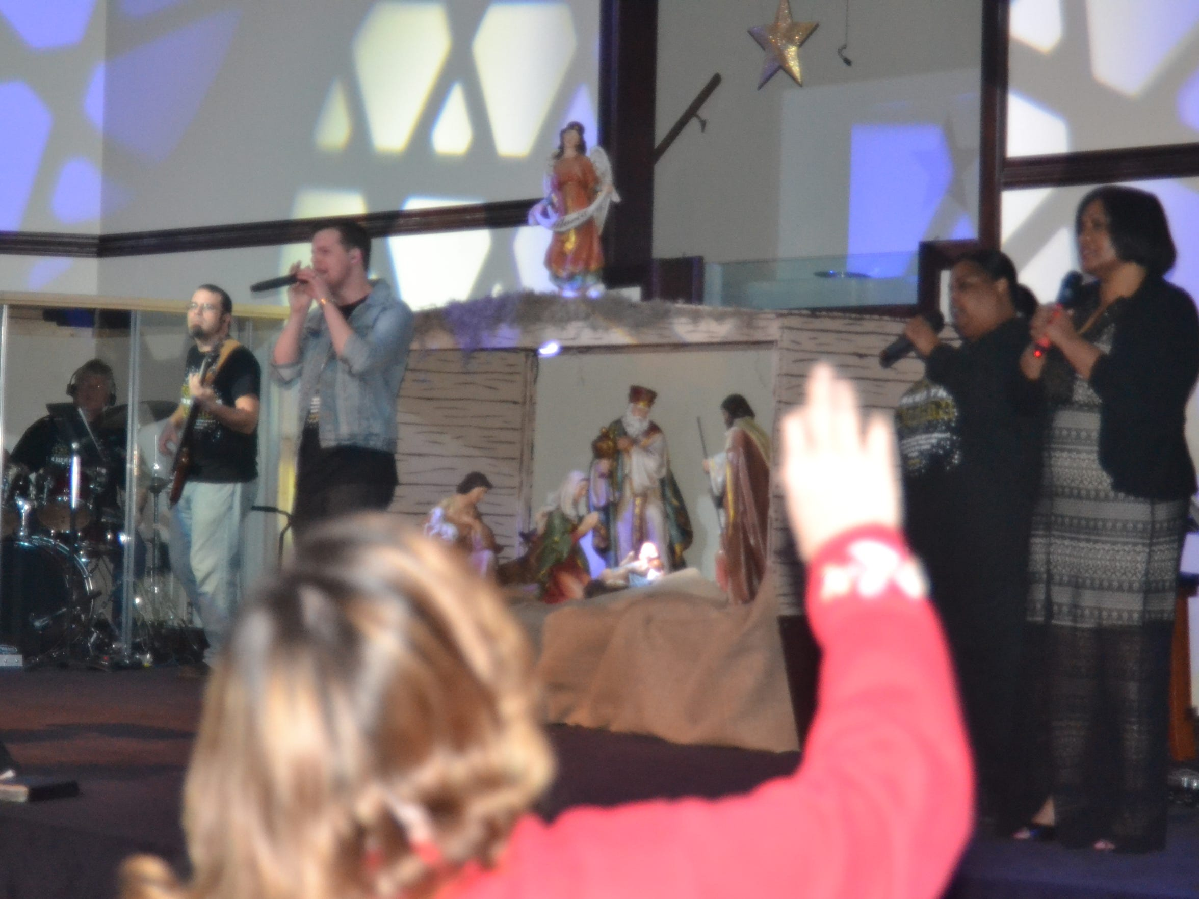 Worshipers celebrate with Journey Church's band Sunday.