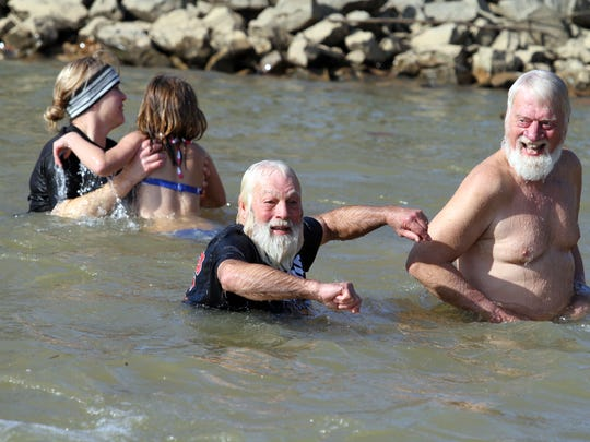 A huge crowd came out in 37-degree weather to observe or take a polar plunge on New Year's Day.